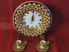 Wall clock and candlestick